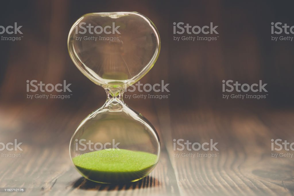 Hourglass as a concept of past time, lost time or completed cases....