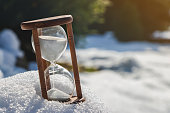 istock Hourglass as a symbol of changing season. Winter is coming. 1042631466