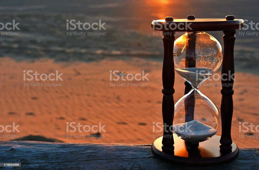 hourglass at sunset stock photo