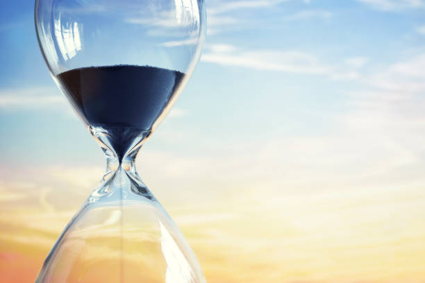 hourglass at sunset - countdown stock photos and pictures