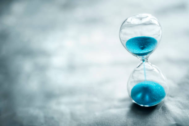 Hourglass background concept for time passing stock photo