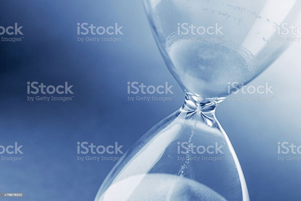 Hourglass clock on light blue background stock photo