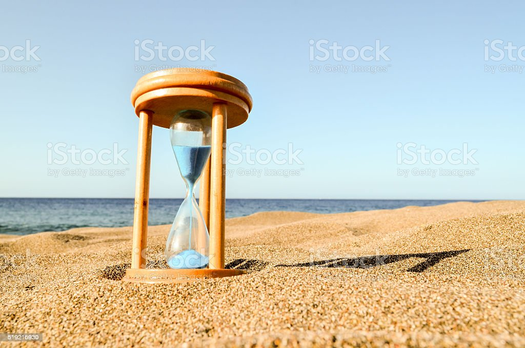 Hourglass Clock on the Sand Beach stock photo
