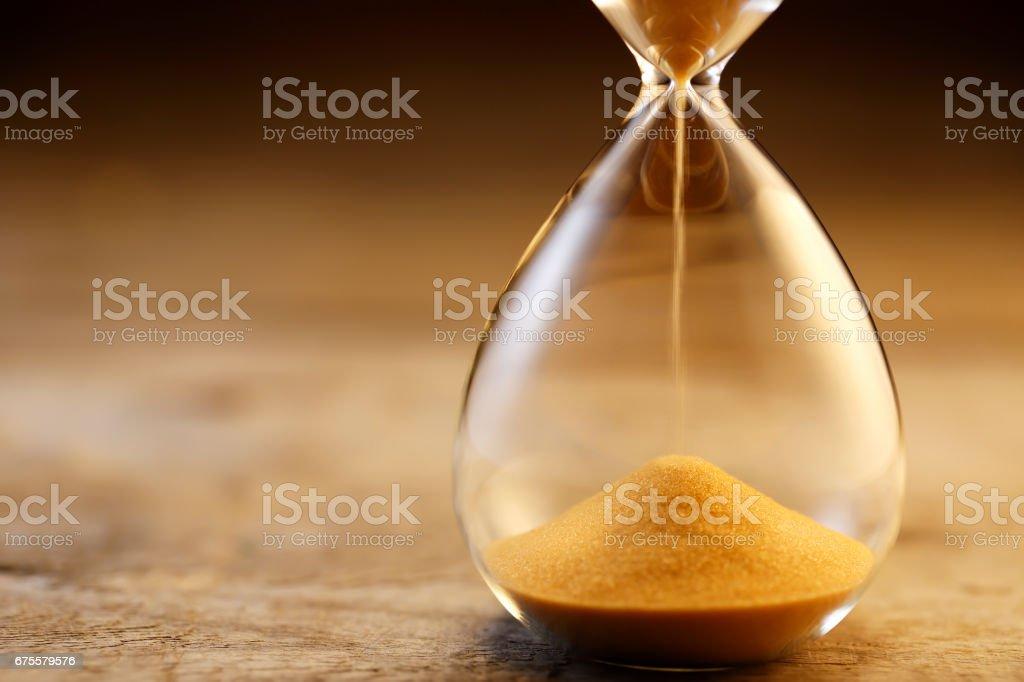 Hourglass flow stock photo