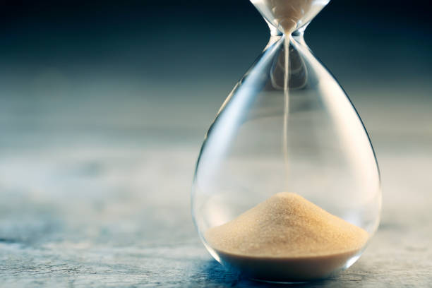 Hourglass flow stock photo