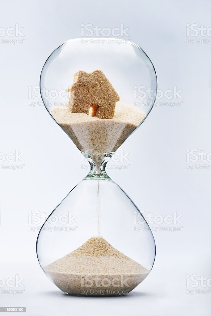 Hourglass house mortgage concept stock photo