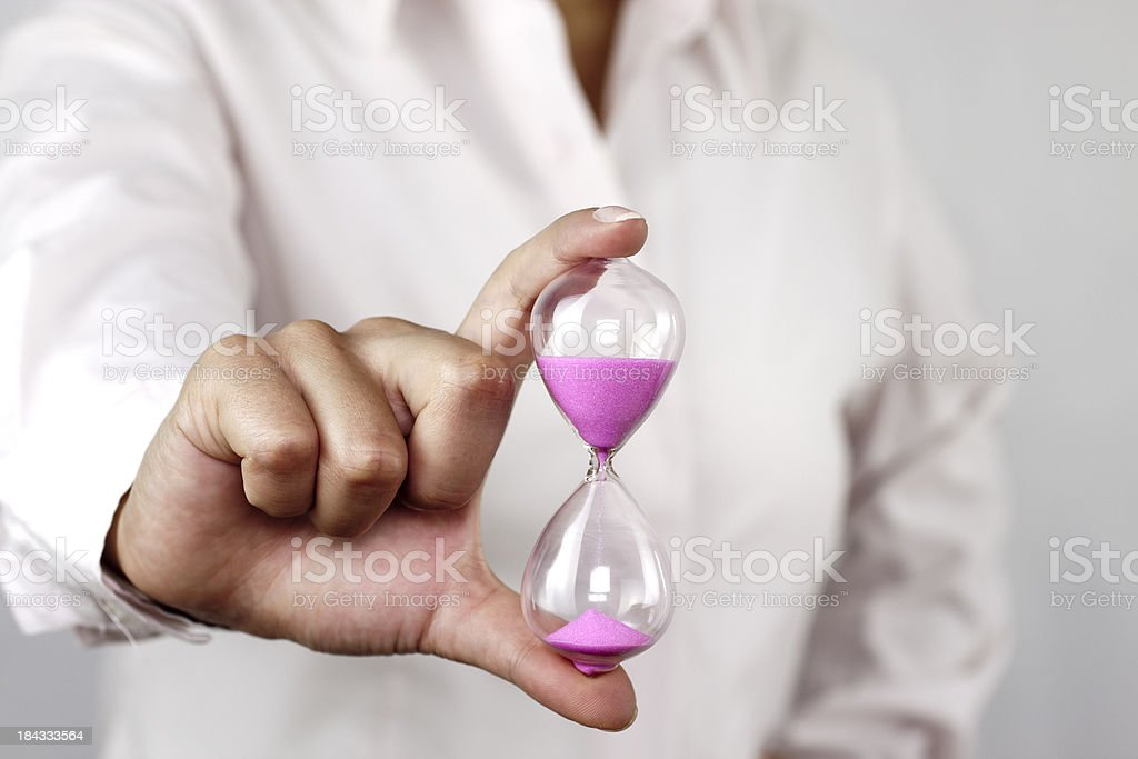Hourglass in hands royalty-free stock photo