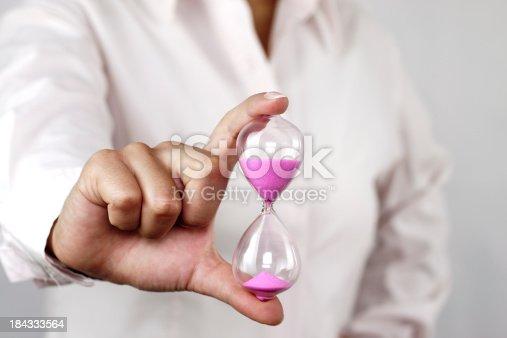 Hourglass in hands