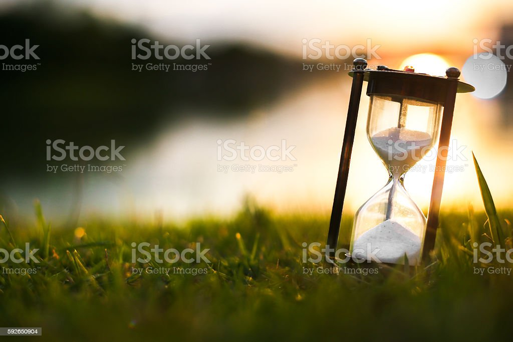 Hourglass in the dawn time stock photo