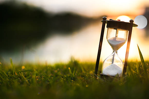 hourglass in the dawn time - sanduhr stock-fotos und bilder