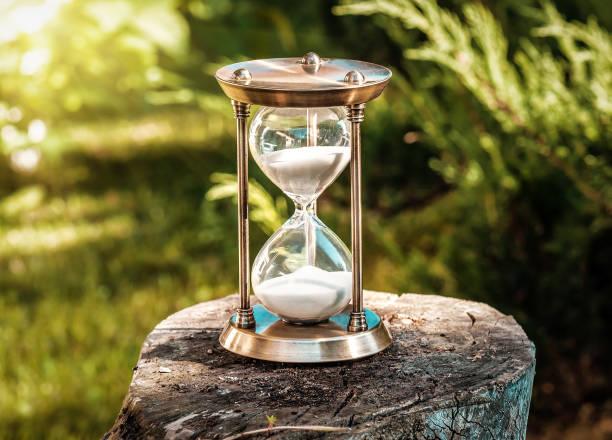 hourglass in the garden stock photo