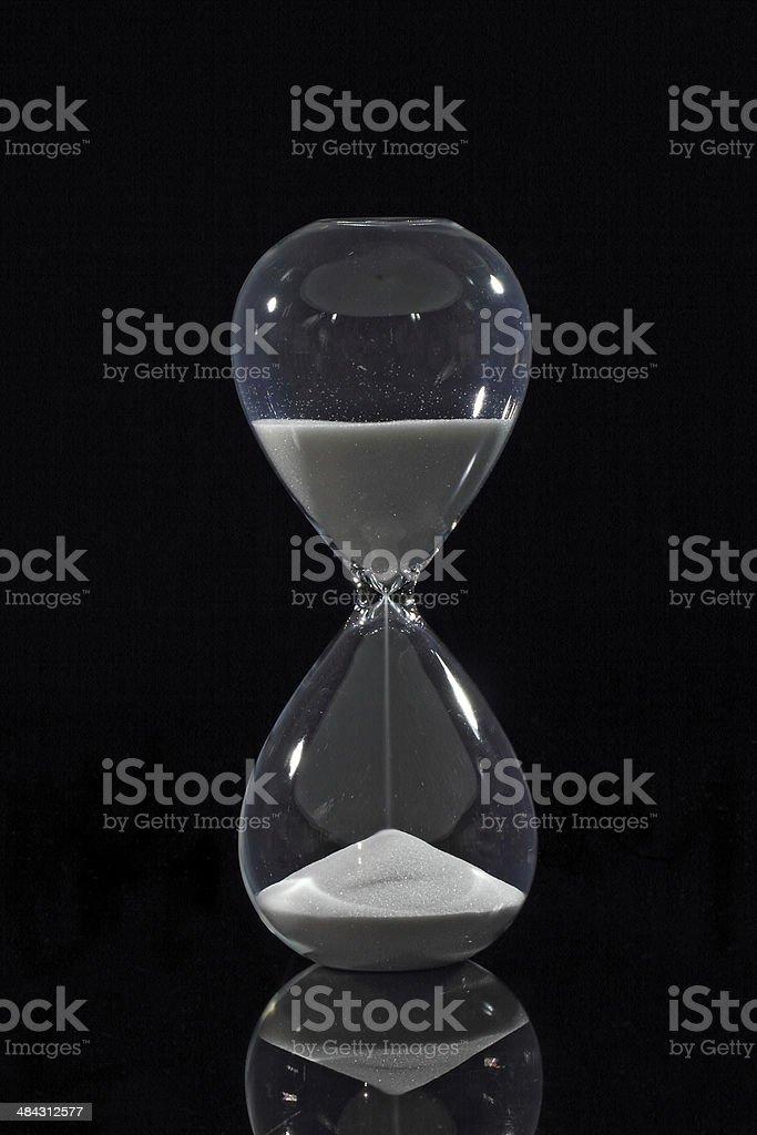 Hourglass isolated on black stock photo
