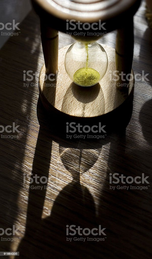 hourglass measuring time stock photo