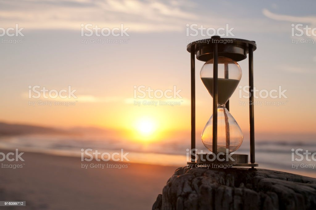 Hourglass on a Beaxh at Sunsrise, stock photo
