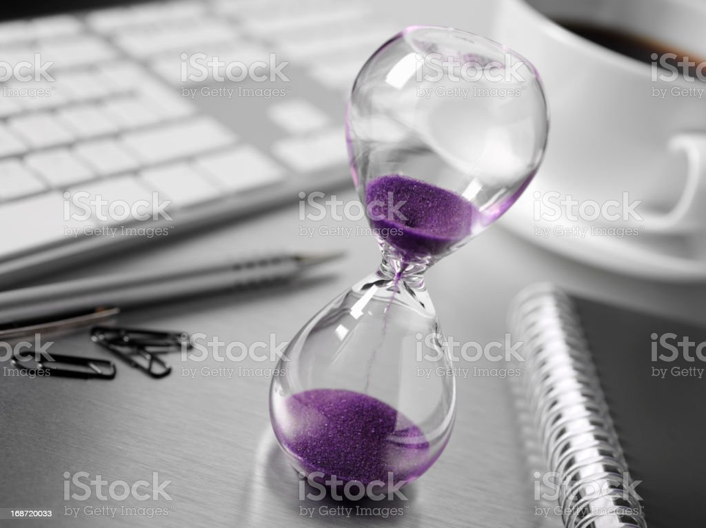 Hourglass on a Office Desk royalty-free stock photo