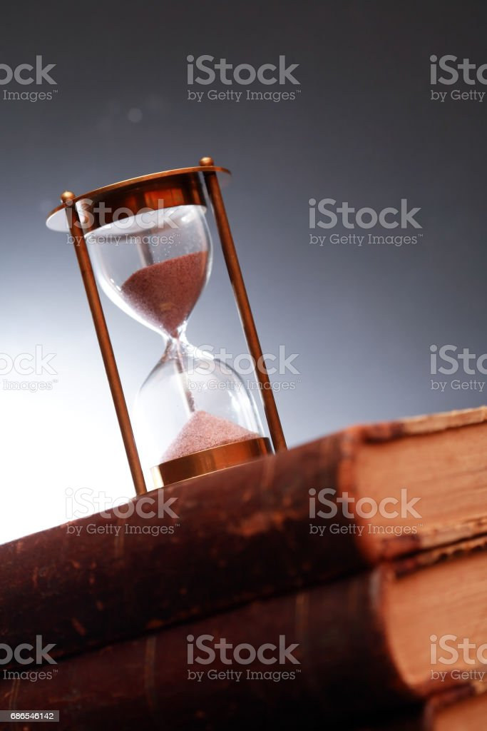 Hourglass On Book royalty free stockfoto