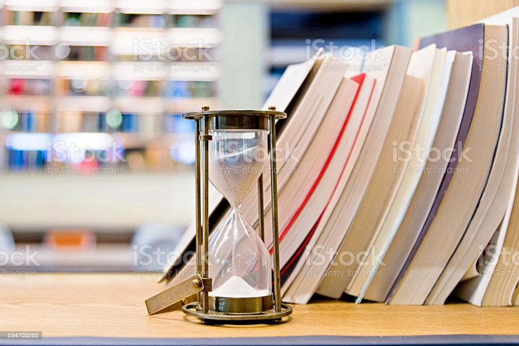 hourglass on a bookshelf