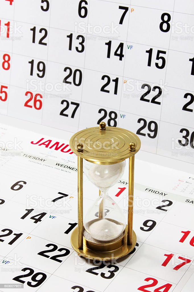 Hourglass on Calendar Page stock photo