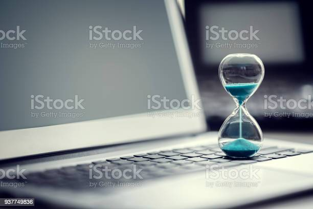 Hourglass on laptop computer concept for time management picture id937749836?b=1&k=6&m=937749836&s=612x612&h=yqs1tbmhxs7ohymxsynbl2mil5h1nlm 0u2gafrnkls=