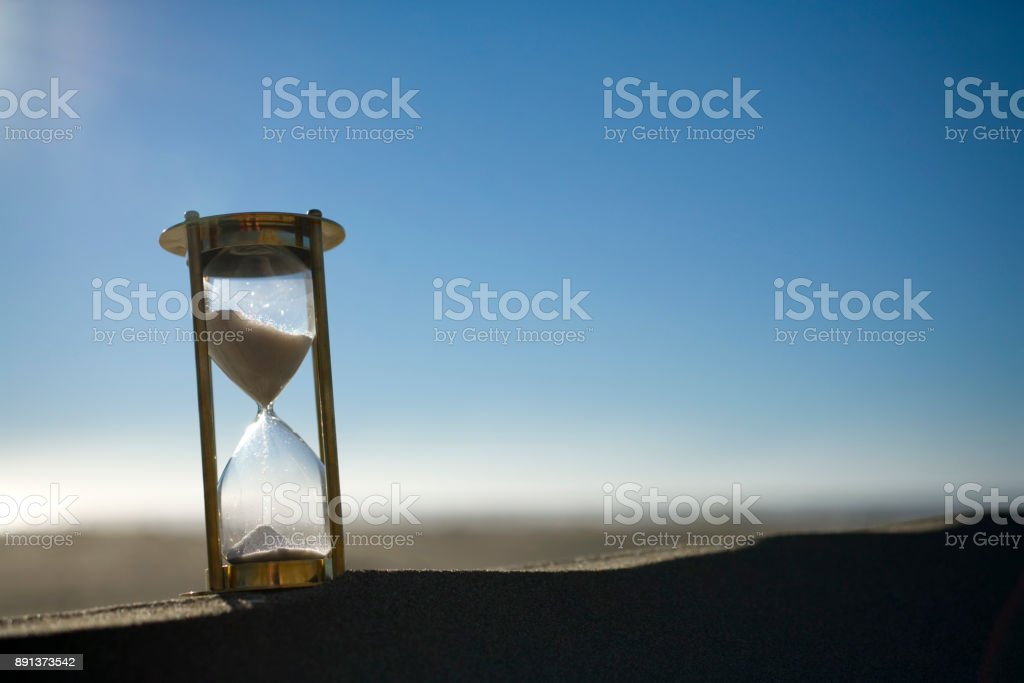Hourglass or Sand Timer Outside on Sand Dune stock photo