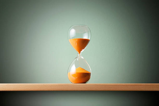 Hourglass Hourglass on the shelf. timer stock pictures, royalty-free photos & images
