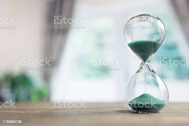 Hourglass time passing in room by window picture id1133384135?b=1&k=6&m=1133384135&s=612x612&h=c7dsfdepxtfu0ddnc1ulhxoqyry78d o6mbx2wzl tw=