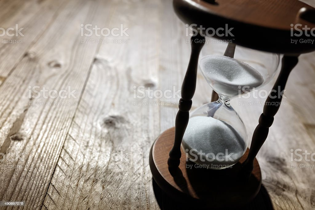 Hourglass time passing stock photo