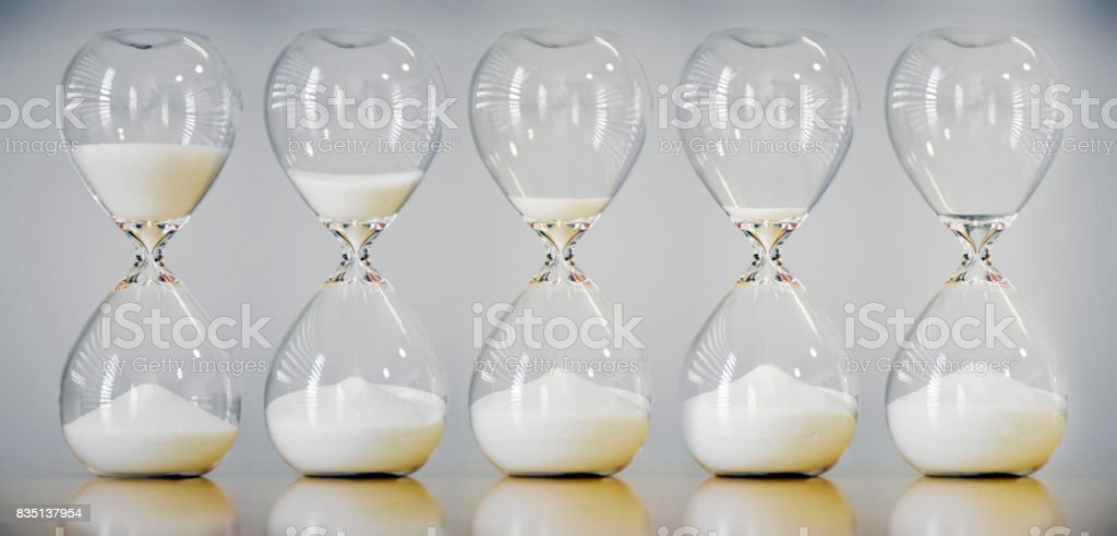 Hourglass time sequence form beginning to the end of one direction stock photo