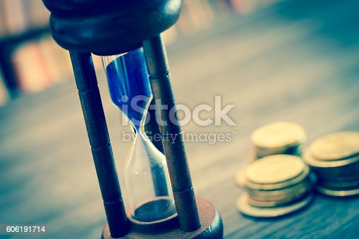 istock Hourglass with coins 606191714