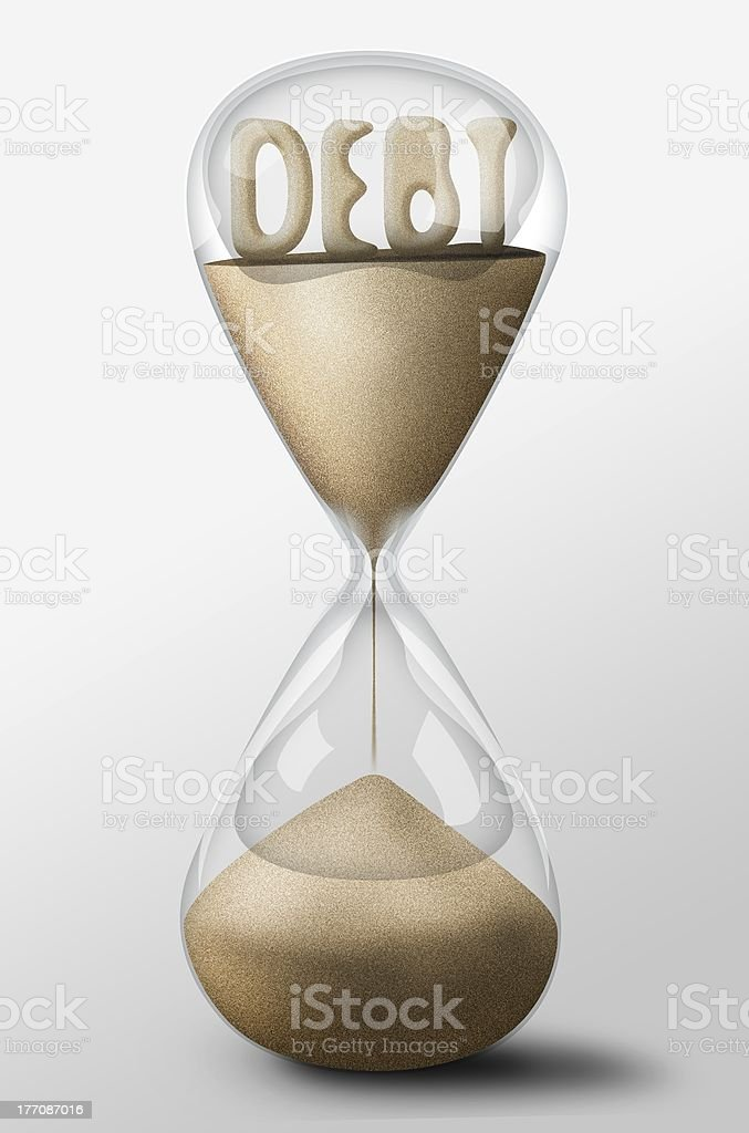 Hourglass with Debt made of sand. Concept spending money royalty-free stock photo