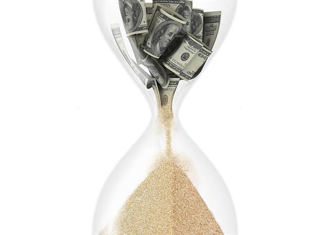 Sablier et dollar à l'intérieur (temps est le concept d'argent) - Photo