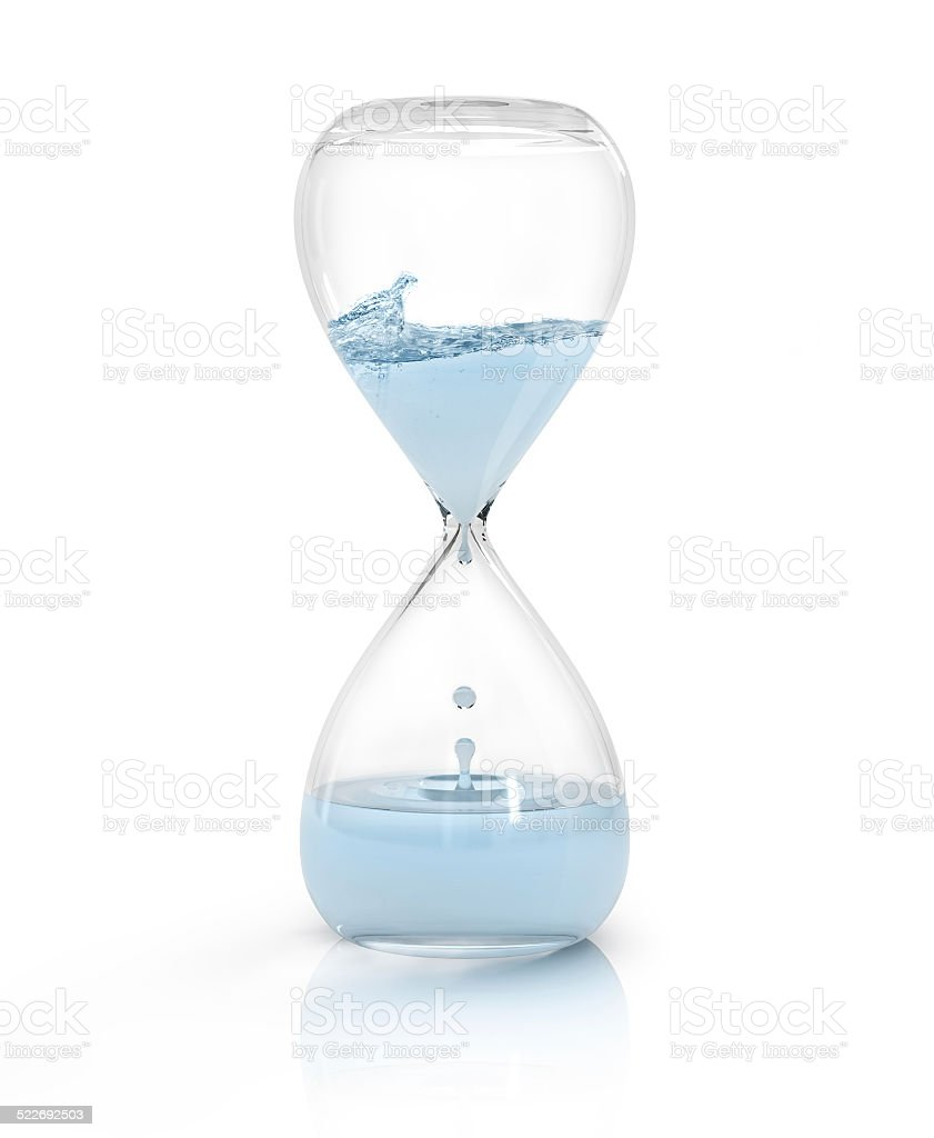hourglass with dripping water close-up, time concept stock photo