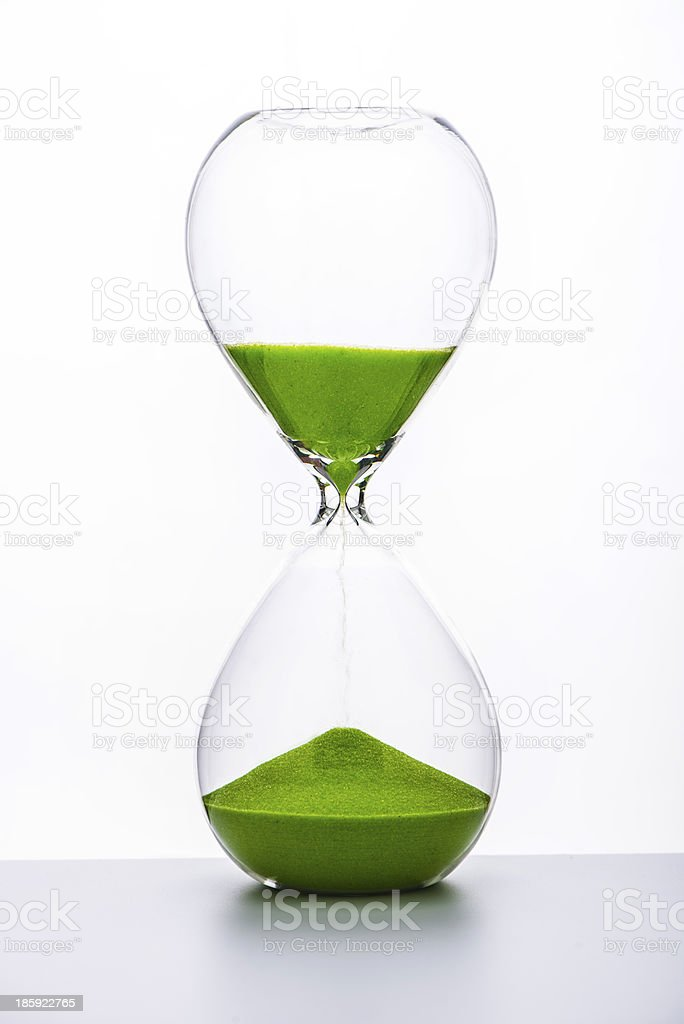 Hourglass with green sand stock photo