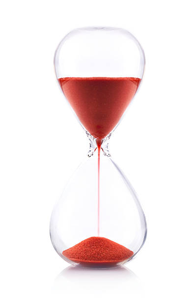 Hourglass with red sand on white background - Time concept Hourglass on white timer stock pictures, royalty-free photos & images