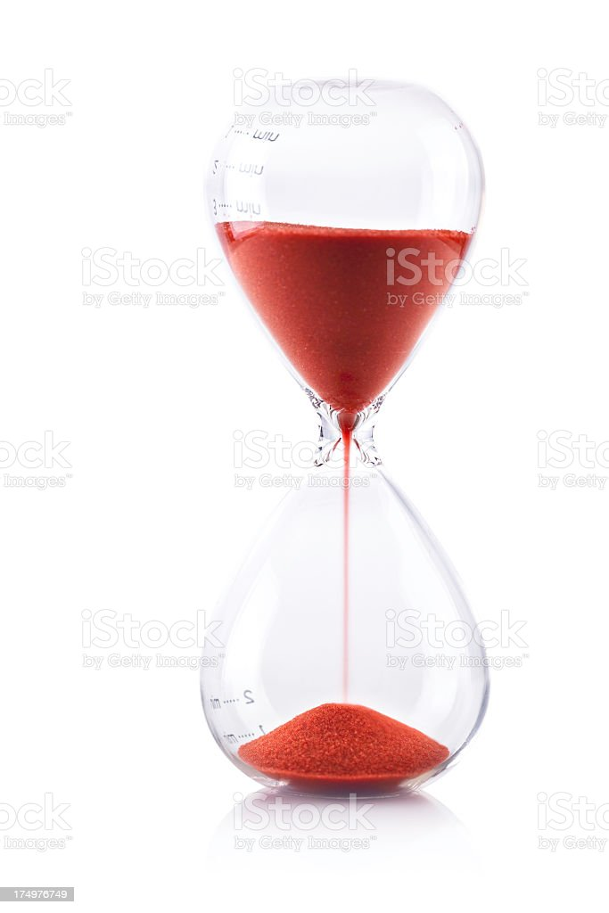 Hourglass with red sand time is running fast stock photo