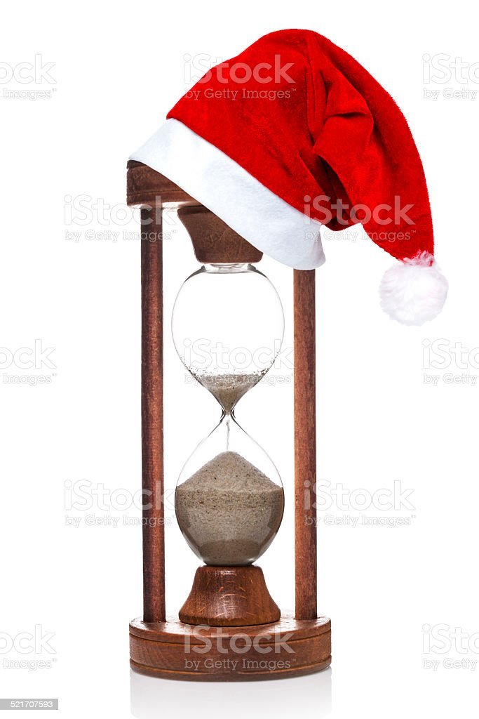 hourglass with Santa Claus hat stock photo