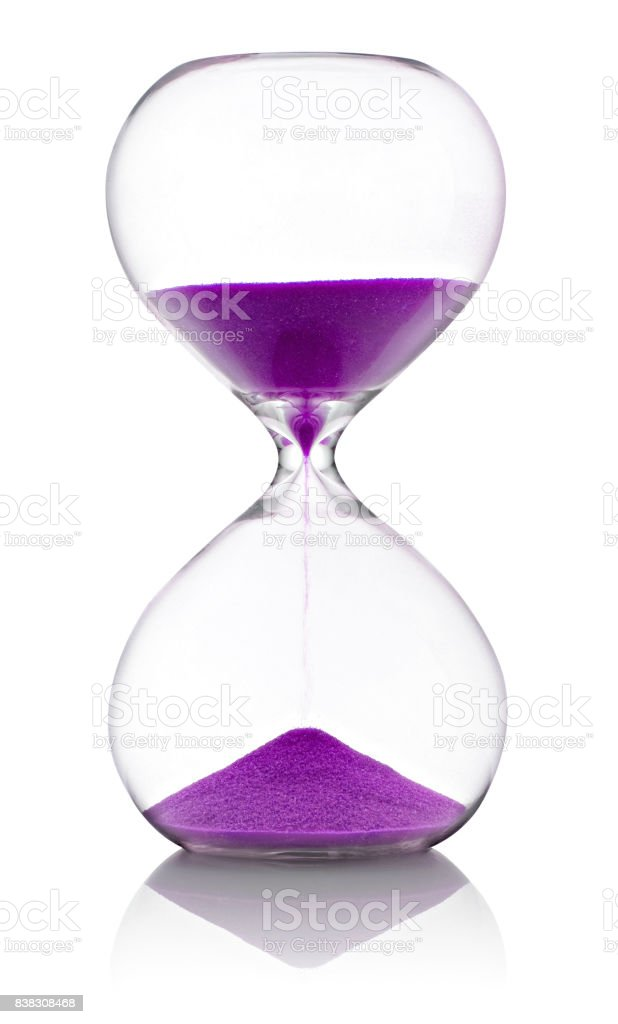 Hourglass with violet sand on white background stock photo