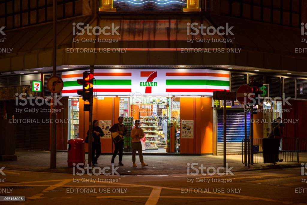 24 hours convenience store 7-11 or 7-Eleven opening all night make bright night road and safety in Hong Kong. 24 November 2017. stock photo