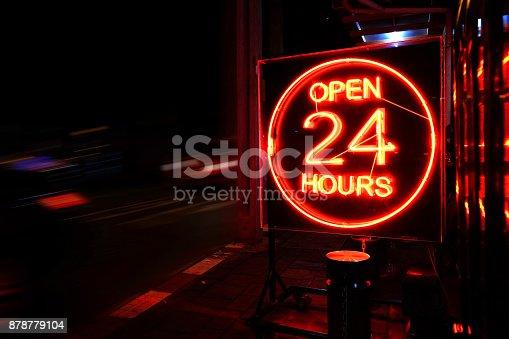 istock 25 Hours neon sign. 878779104