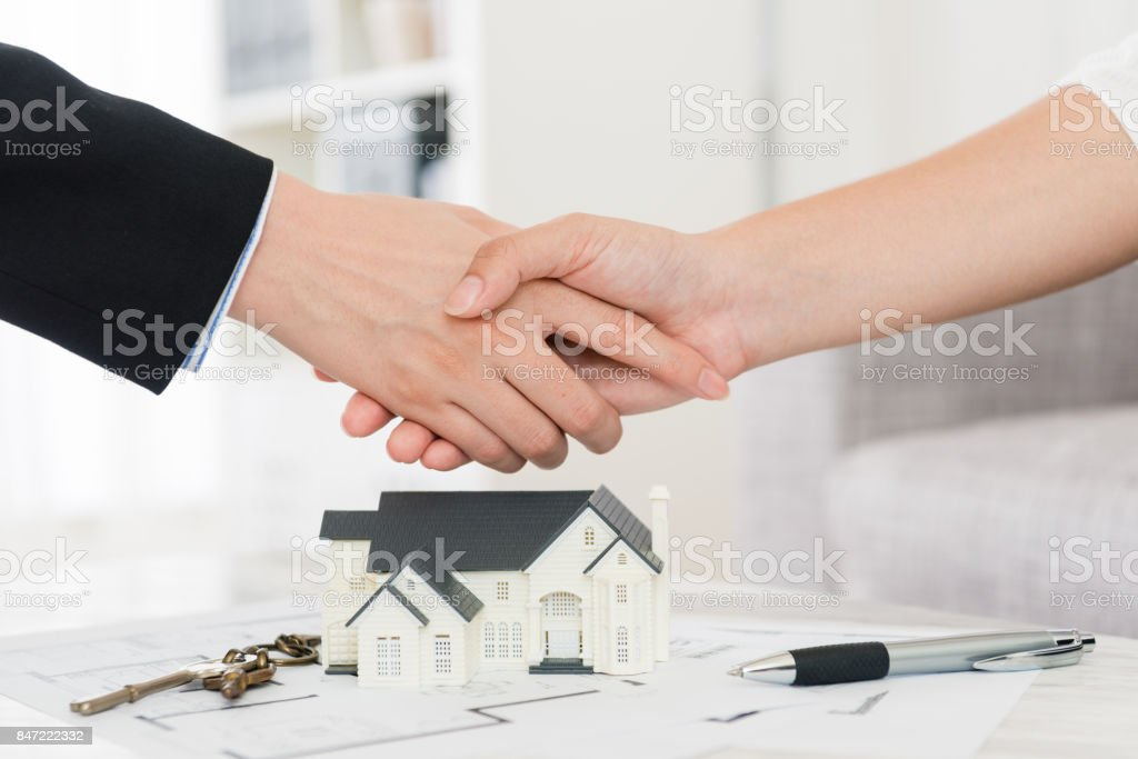 house agent successfully selling building scheme stock photo