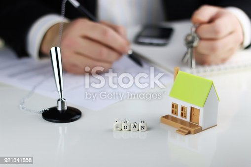 istock House Agents hands contract loan mortgage 921341858