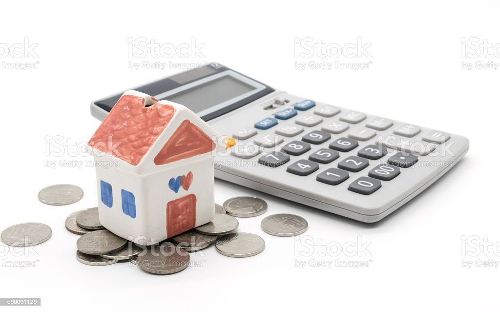 House and calculator on white background royalty-free stock photo