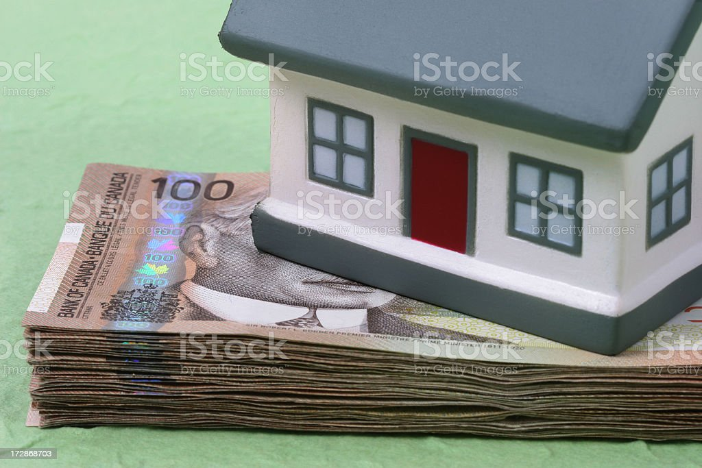 House and Canadian Money royalty-free stock photo