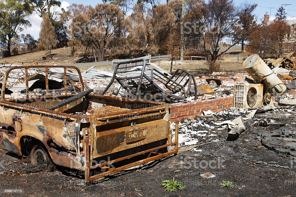 House and car destroyed by catastrophic bushfire royalty-free stock photo