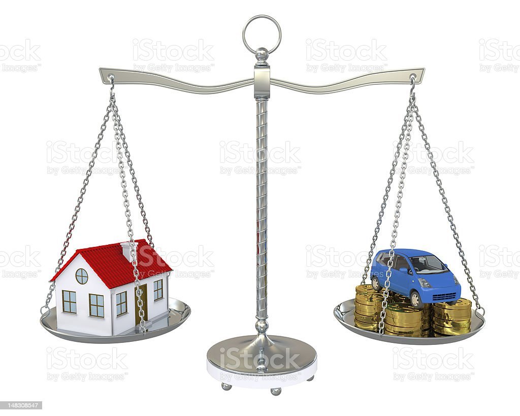 House and car with the coins on scale royalty-free stock photo