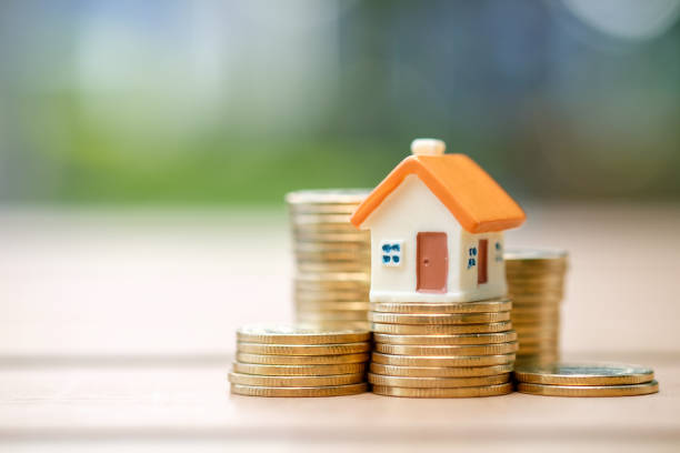 House and coins stack. Mini house on stack of coins. Concept of Investment property. renting stock pictures, royalty-free photos & images