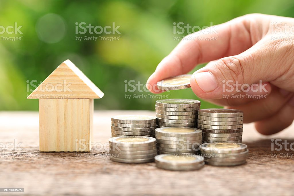 House and coins stack. stock photo