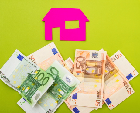A house over a pile of euros