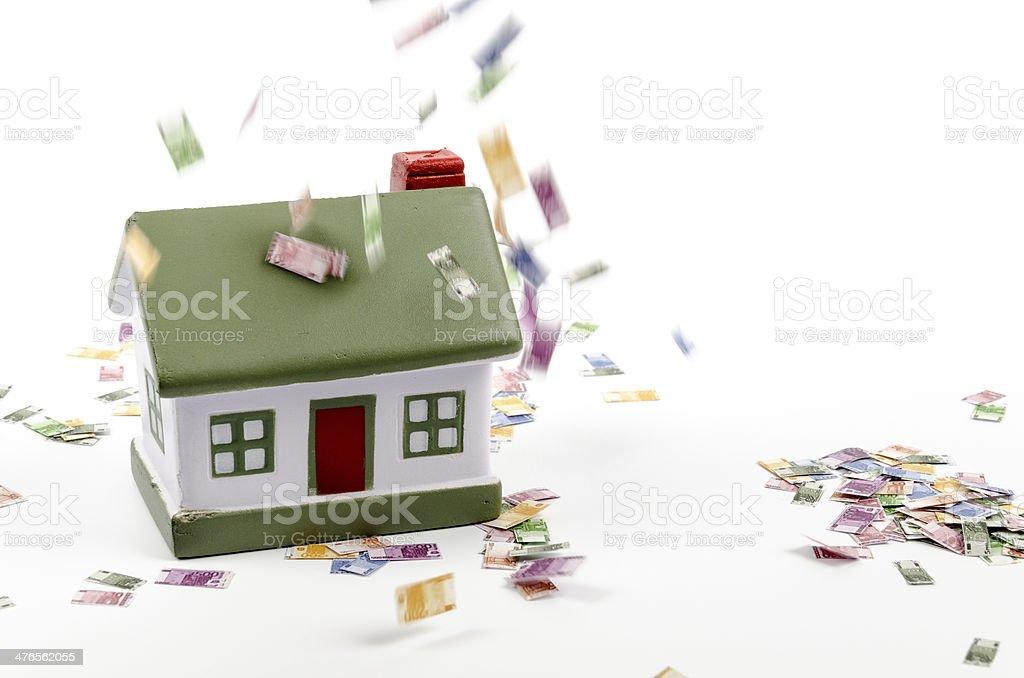House and falling euro money stock photo