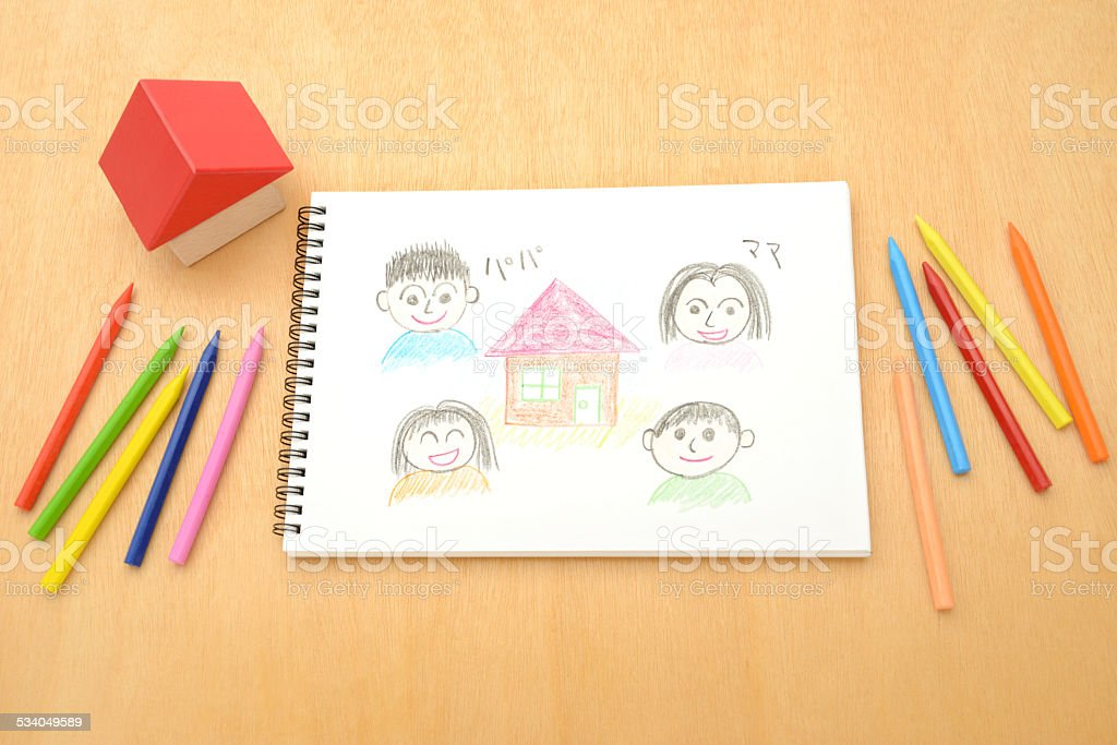 House and family drawing on sketchbook stock photo